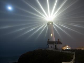 обои Маяк на побережье светит фото