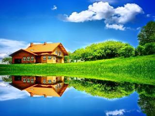обои Домик на зеленим лугу у пруда фото