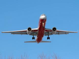 обои Небольшой самолет в бирюзовом небе фото