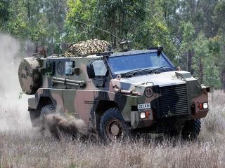 обои Bushmaster MRAP Cat II 1998 сбоку фото