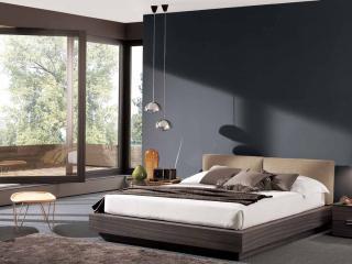 обои Уютная кровать в спальне фото