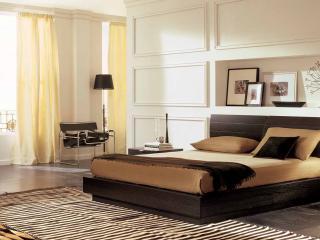 обои Мягкая кровать в спальне фото