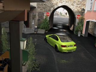 обои Зеленая бмв возле въезда в арку фото