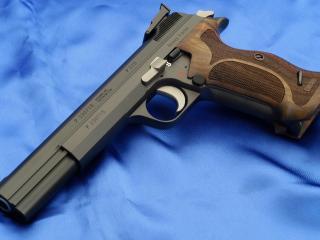 обои Пистолет Sig p210 на синем  фоне фото