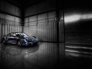 обои Блестящее авто в черном ангаре фото