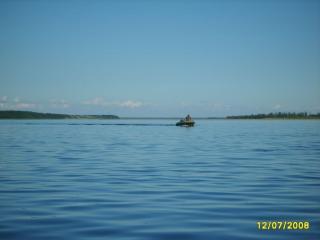 обои Рыбак на лодке фото