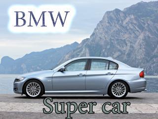обои BMW на фоне неба и белых гор фото