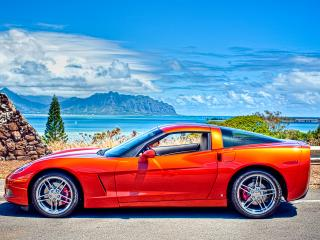 обои Красный автомобиль на фоне моря фото