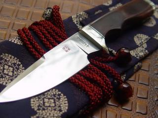 обои Стальной нож с клеймом фото