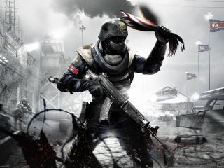 обои Homefront,   боец востания с обгорелым флагом фото