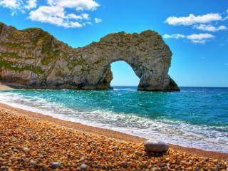 обои Арочная скала на берегу моря фото
