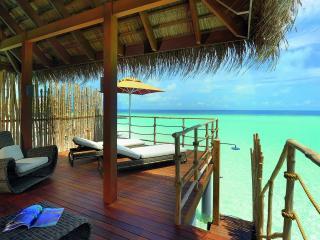 обои Мальдивы,   бунгало на берегу океана фото