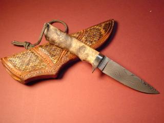 обои Красивый нож с кожаной кобурой фото