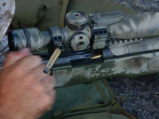 обои Выстрел винтовки и гильза фото
