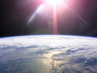 обои Земля и солнце фото