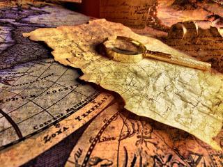 обои Записка и лупа на старинной карте фото