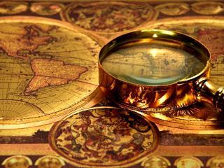обои Старинная лупа на карте фото
