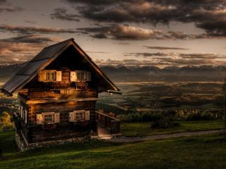 обои Деревянный домик на холме фото