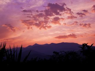 обои Закат над тропиками,   холмы вдали фото