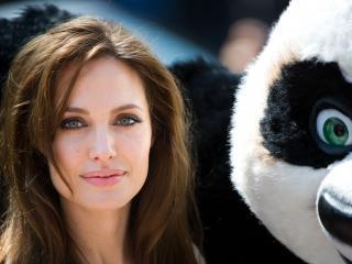 обои Анжелина с плюшевой пандой фото