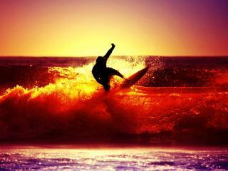обои Серфингист на красном гребне волны фото