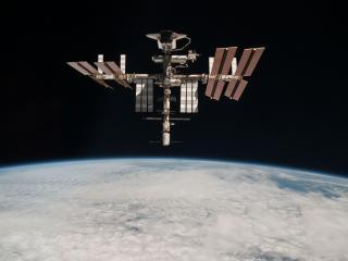 обои Спутник на земной орбите фото