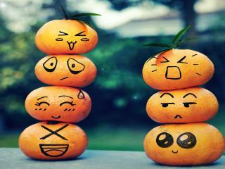обои Нарисованные гримасы на мандаринах фото