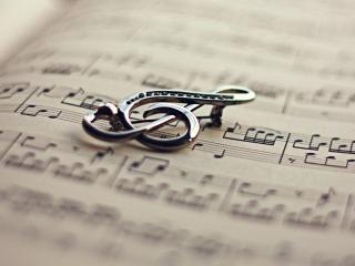 обои Скрипичный ключ на нотах фото