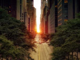 обои Солнце сквозь просветы между домами фото