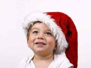 обои Малыш веселый в новогоднем колпаке фото