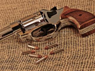 обои Небольщой револьвер с патронами фото