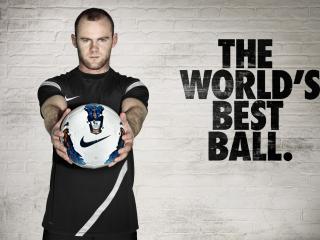 обои Мужчина с мячом и надпись на стене фото