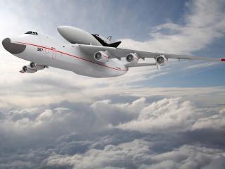 обои Самолет перевозчик выше облаков фото