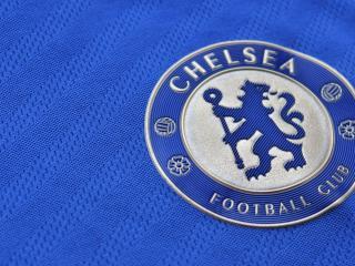 обои Эмблема футбольного клуба на голубой материи фото