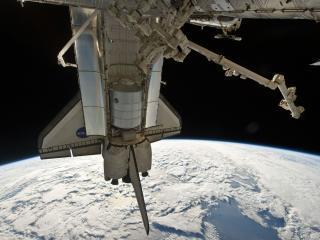 обои Космическая станция Насса над Землей фото