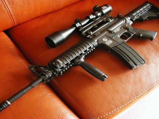 обои Снайперская винтовка на сидении фото