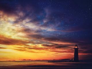 обои Маяк у моря под небом вечера фото