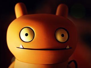 обои Игрушка с большими глазами и клыками фото
