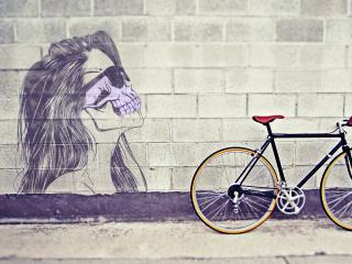 обои для рабочего стола: Велосипед у стены с рисунком