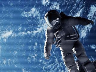 обои Космонавт в скафандре в открытом космосе фото