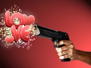 обои Выстрел любовью из пистолета фото