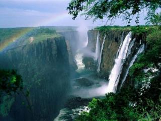 обои Радуга над скалой и водопадами фото