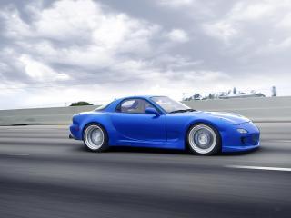 обои Mazda RX-7 Blue мчится по дороге фото