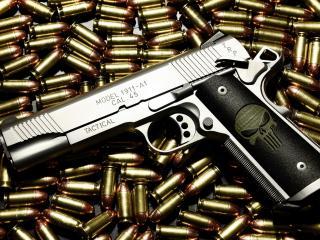 обои Череп на рукоятке пистолета и пули фото