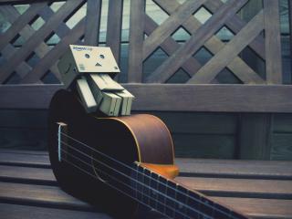 обои Гитара и человек коробка фото