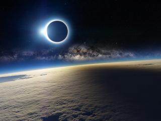 обои Солнечное затмение над Землей фото