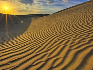 обои Закат и волнистый песок фото