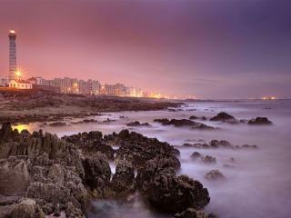 обои Маяк и город у моря фото