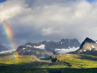 обои Радуга на небе в горах со снегом фото