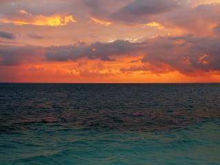 обои Багряные облака над морем фото